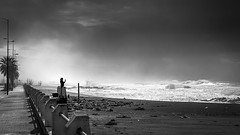 Recording the storm - Paola, Italy - Street photography (Giuseppe Milo (www.pixael.com)) Tags: fineart winter recording italy weather socialmedia sea beach phone waves streetphotography black woman iphone sky storm clouds blackandwhite paola white provinceofcosenza onsale