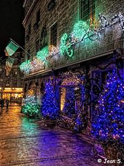 ... (Jean S..) Tags: street sidewalk people lights xmas restaurant night flags