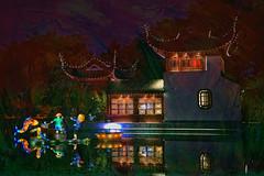Colorful Night Reflections (jta1950) Tags: reflections night dark light montrealbotanicalgarden gardenoflight water figurine statue