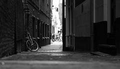 When life gets complicated...just ride (Michael Kalognomos) Tags: sony photography cinematography sony35mmf18oss streetstories streetlife stilllife amsterdam netherlands bicycle streetphotography urbanlandscape alley light blackandwhite bw bokeh depthoffield dof sonya6400