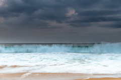 Rain Clouds and Early Morning Seascape (Merrillie) Tags: daybreak wamberalbeach sand sunrise sea cloudy australia centralcoast surf morning wamberal rainclouds newsouthwales waves earlymorning nsw landscape beach ocean dawn waterscape clouds coastal nature outdoors seascape water coast sky seaside