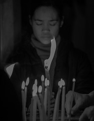 Burning Inside (ybiberman) Tags: israel jerusalem oldcity alquds christianquarter churchoftheholysepulchre stoneofatonement woman pilgrim pray portrait candid streetphotography documentary people candles light bw blackandwhite closedeyes