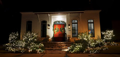 Red doors, green wreaths, white lights (Monceau) Tags: christmas lights night nightime decorations