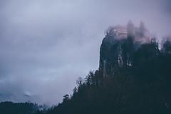 Bled Castle covered in a foggy veil (freyavev) Tags: bled lakebled bledlake gorenjska castle foggy fog mood rain moody nature outdoor slovenia slovenija feelslovenia zoomlens raining balkans julianalps
