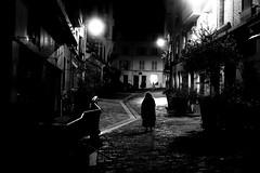 Dark thoughts (pascalcolin1) Tags: paris femme woman sombre dark lumière light réverbères lamppost pavés pavement ombres shade photoderue streetview urbanarte noiretblanc blackandwhite photopascalcolin 50mm canon50mm canon street