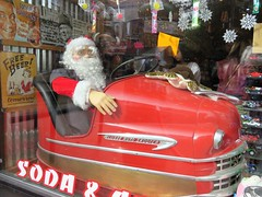 Looks Like Santa Had Too Much Free Beer! (Patricia Henschen) Tags: lusse auto scooter santa beer sign display boulder colorado christmas window store advertising