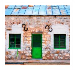 Tin Roof and Stone Walls (Daniela 59) Tags: building stonewall windows door green old outbuilding historic grünau namibia wednesdaywalls danielaruppel