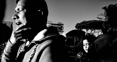 Positive rays. (Baz 120) Tags: candid candidstreet candidportrait city contrast street streetphoto streetcandid streetportrait strangers rome roma ricohgrii europe monochrome monotone mono noiretblanc bw blackandwhite urban life portrait people provoke italy italia grittystreetphotography faces decisivemoment