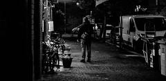 Indecision. (Baz 120) Tags: candid candidstreet candidportrait city contrast street streetphoto streetcandid streetportrait strangers sony a7 rome roma europe monochrome monotone mono noiretblanc bw blackandwhite urban life portrait people provoke italy italia grittystreetphotography faces decisivemoment night