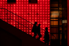 Meeting on the stairs [explored] (devos.ch312) Tags: streetphotography people silhouette red artificiallight sony a7rii a7rm2 zeiss fe35mmf28 christinedevos