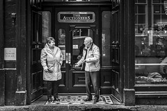 Going Once, Going Twice (Leanne Boulton) Tags: urban street candid streetphotography candidstreetphotography portrait streetlife candidportrait sociallandscape old elderly man woman smoke smoker smoking face cigarette expression mood gesture interaction doorway pub publichouse bar conversation tone texture detail depth naturallight outdoor light shade grainy city scene human life living humanity society culture lifestyle people canon canon5dmkiii ef2470mmf28liiusm black white blackwhite bw mono blackandwhite monochrome glasgow scotland uk