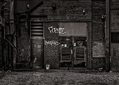 Alleyway Graffiti No 3 (thelearningcurvedotca) Tags: briancarson canada canadian ontario thelearningcurvephotography toronto aged alley alleyway architecture art artistic artwork back background blackwhite blackandwhite brick building city culture dark design dirty exterior facade foto graffiti grafitti grunge lamp lettering letters light monochrome mural old outdoors paint painting pattern perspective photo photograph photography retro scene stone street style symbol tag text texture urban vintage wall