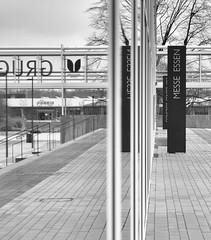Reflection layers (frankdorgathen) Tags: alpha6000 sony18200mm monochrome blackandwhite schwarzweiss schwarzweis fair ruhrgebiet ruhrpott rüttenscheid messeessen architecture architektur spiegelung reflection