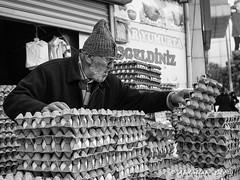 Street 70 (Oktay A) Tags: türkiye istanbul üsküdar streetportrait portrait blackandwhite ishootpeople bnwstreet bnwpeople bnwdemand monochrome arrowcolt human insan art blackandwhitephotography people ifadeler expressions sokak streetphotography topbnw bnw streetfood streetvendor eggseller egg eggvendor nxmini samsungcamera