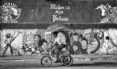 Cycling past a Mural Wall. (Beegee49) Tags: street people cycling graffiti wall happy planet blackandwhite monochrome sony a6000 bw bacolod city philippines asia happyplanet asiafavorites