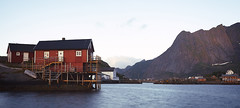 Panorama of fishing village on Lofotens, Norway,  panorama (czdistagon.com) Tags: lofoten village fishing norway traditional house hut arctic harbor nordic scenic norwegian red beautiful isle mountain cottage bay sky town island peaks water coast panorama ocean light reine reinefjorden north tourism scenery sea summer nordland fjord scandinavia picturesque nature lantern rorbuer outdoors landscape weather background ecotourism ecology fish fishermen archipelago