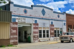 White Pole Garage, Atlantic, IA (Robby Virus) Tags: atlantic iowa ia white pole garage ghost sign signage signs firestone tires ad advertisement painted faded automobile ford