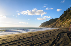 Far Away Beach (Ash and Debris) Tags: ca rock usa sand landscape sunset pacificocean water tracks trace waves view california light beach ocean trees shore track traces coluds sky sunlight unitedstates nature pacific rocks