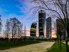 Citylife all'alba (alfsan) Tags: citylife sunrise towers trees sky stripes colours orange pink blue yellow crane iphone