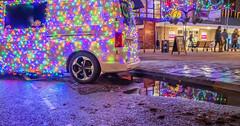 Portishead Christmas Market. (tramsteer) Tags: tramsteer whitevan christmaslights puddle pavement sidewalk people rain weather