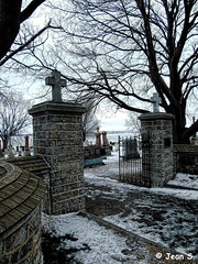 ... (Jean S..) Tags: cemetery river water entrance fence stone graves graveyard snow sky dark trees