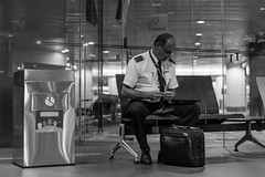 Getting Ready (Robycrux) Tags: pilot airport airplane changi singapore waiting sony prime smoking