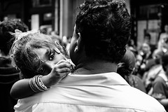 In daddy's arms (Aurélien B.) Tags: paris fêteindienne streetphotography ganesh festival indian daddy arms quiet glance girl