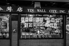 (jfre81) Tags: chicago chinatown cermak pedestrian mall yin wall city store window sign storefront chinese asian products goods food candy medicine price sale import 312 windy second urban culture james fremont photography jfre81 canon rebel xs black white blackandwhite bw