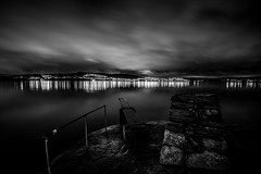 Christmas Day (Jhfred) Tags: bergen norway helleneset black white night evening christmas day reflection sea ocean water lights rocks shoreline clouds long exposure