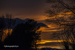 Moody Sky (Photographybyjw) Tags: moody sky warm colors clouds this unusual sunset found north carolina ©photographybyjw rural country trees foliage