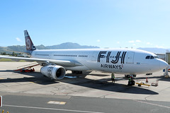 Fiji Airways A330-200 DQ-FJT at the gate at NAN/NFFN (Jaws300) Tags: canon5d fijiairways remotestand nadi ef28300mm ef28300 28300mm tropical airplane nadiinternationalairport international 5d canon eos gate terminal tropics stand mountain mountains hills fiji airways a330200 dqfjt departing a330 airbus a332 dq fj takeoff south pacific southpacific island islands green greenery scenic paradise stormy storm clouds cloudy nan nffn airport ramp apron runway bula islandoftaveuni jt