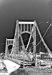 Puente colgante,como un fantasma se recorta en el recuerdo. (-Ana Lía-) Tags: nikon colgante flickr puente necochea río quequén monocromático bw bn arquitectura orilla imagen exterior noche buenosaires argentina nikond40 fantasma analialarroude