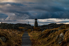 The rugged coast (langdon10) Tags: fishermansmemorial karmøy norway clouds lighthouse rock