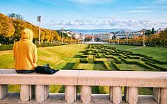 yellow hoodie (khrawlings) Tags: yellow green hoodie ferris wheel portugal lisbon targus river city view sitting park parqueeduardovii miradouro