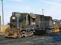 PC 7646, RS11, Kearny, NJ.   11-12-1976 (jackdk) Tags: train railroad railway locomotive locomotiveroster roster pc penncentral pennsy cr conrail highhood standardcab fallenflag alco alcors11 rs11 pc7646 cr7646 7646 kearny kearnynj engineterminal meadows