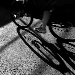 bike shadow (heinzkren) Tags: schwarzweis blackandwhite monochrome canon canonr eos eosr shadow woman street streetphotography bicycle bike abstract minimalism frau sport square