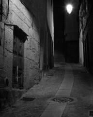 Wrapped in light (lebre.jaime) Tags: portugal beira covilhã nocturnal nightphotography street house architecture traditionalarchitecture analog film135 bw blackwhite noiretblanc nb pb pretobranco ptbw kodak tmax3200 tmz2 leicam3 summicron2050dr epson v600 affinity affinityphoto