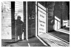 Project(ion) (leo.roos) Tags: shop window glass shopwindow reflection projection text shadow noir monster westland noiretblanc bw schaduw licht lichtsch zon tekst 28 raam glas glasdoor a7rii sonyfe228 sonyfe28mmf2 sel28f20 darosa leoroos 2019