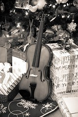 Music for Christmas (Karen_Chappell) Tags: xmas noel holiday christmas bw violin instrument music blackandwhite stilllife canonef24105mmf4lisusm presents gifts present decor decoration christmastree ornaments