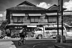 Street scene (Beegee49) Tags: street people cycling scene wooden building blackandwhite monochrome sony a6000 bw bacolod city philippines asia happyplanet asiafavorites