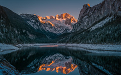Red Mountain (gregor158) Tags: mountains mountain snow winter sunset orange glacier ice blue tree trees reflection lake austria österreich gosau gosausee europe landscape places travel dachstein massif