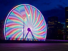 Wheely Pride (ahockley) Tags: afterdark carnival ferriswheel motionblur night oregon pdx portland pride rainbow rosefestival shotonolympus spinning