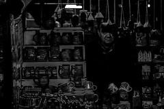 Photo (BadSoull) Tags: prague evening trip walk photo street people randompeopleatstreet 2019 black white bnw man salesman shop shadow sony a6300 mirrorless streetphotography