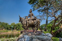 Sculpture of Phra Sukra in the Garden of the Gods in Muang Boran in Samut Phrakan, Thailand (UweBKK (α 77 on )) Tags: muang mueang boran ancient city siam samutphrakan samut phrakan province thailand bangkok southeast asia sony alpha 77 slt dslr garden park outdoors open air museum recreation education culture history historical sculpture phrasukra phra sukra bronze statue gardenofthegods gods god tree lake