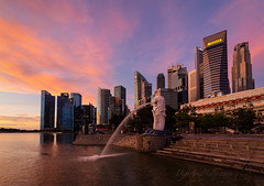 Sunrise in Singapore (Dan and Holly) Tags: asia blue danandhollythompson longexposure merlion orange red singapore skyline buildings city citylights cityscape coast danandhollycom life national pink shadows wall water yellow