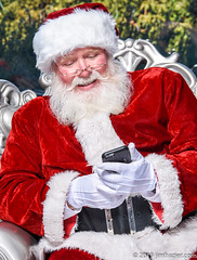 Ever since he realized Facebook and Google were already checking who's naughty or nice, it's been a real time-saver for Santa. (Jim Frazier) Tags: 2019 20191223cantignysanta 2019cantigny lejardin alienbees cantigny cantignypark caption cellphones checking children christmas december dupage dupagecounty flash funny groupportrait humor il illinois inspecting jimfraziercom list looking parks people portrait portraits portraiture q3 reading red santa santaclaus sizeover1000 strobes strobist toreadytoexport tosave wheaton winter v1000