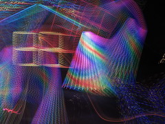 Kaliadscope Dances (moonjazz) Tags: color lights holiday 88 decorations christmas pink swirl experiment timeexposure house blue rainbow wild moonjazz yellow night strange vivid patterns kaleidoscope polychrome iridescent hues purple imagination creativity dazzling