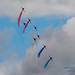 RAF Red Arrows Dancing in Colour Under the Clouds