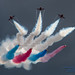 A RED ARROWS' COLOURFUL PALM SPLIT UNDER THE OVERCAST