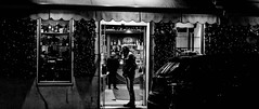 The demon drink. (Baz 120) Tags: candid candidstreet candidportrait city contrast street streetphoto streetcandid streetportrait strangers sony a7 rome roma europe women monochrome monotone mono noiretblanc blackandwhite bw urban night life portrait people italy italia grittystreetphotography faces decisivemoment
